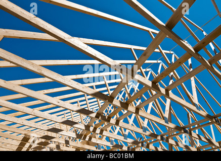 Shadows of a timber roof truss on a block wall stock photo for Manufactured roof trusses