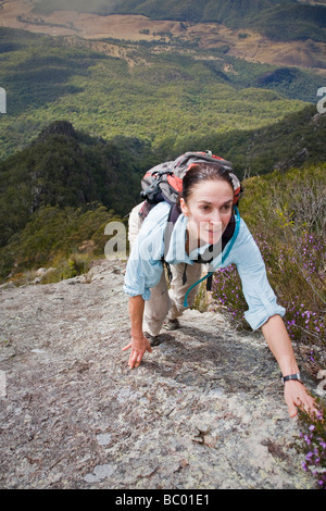 A woman climbing the Northeast ridge on Mount Barney. - Stock Photo