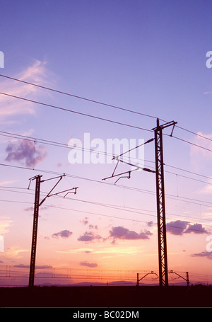 Catenary at sunset. Madrid province. Spain. - Stock Photo