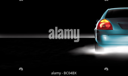Cropped image of car showing tail light and indicator - Stock Photo