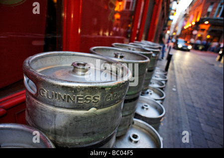 Rows of empty Guinness barrels stacked up in an alleyway outside a pub Dublin Republic of Ireland - Stock Photo