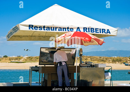Prepairing fish, Ferragudo, Algarve Portugal. - Stock Photo