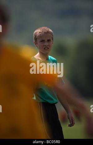 Boy Playing Soccer - USA - Stock Photo