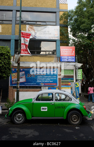 Green Mexican Volkswagen Beetle Taxi parked in a Condessa street, Mexico City - Stock Photo