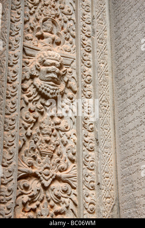 Decorative stone carvings on wall of [Preah Ko] temple ruins, [Roluos Group], Angkor, Cambodia - Stock Photo