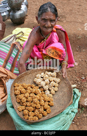 Indian Woman Of The Paroja Tribe Selling Sweet Pastries, Orissa - Stock Photo