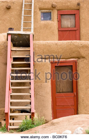 Red Doors and Ladders Taos Pueblo New Mexico - Stock Photo