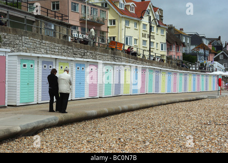 A row of pastel painted beach huts on the esplanade at Lyme Regis, Dorset, UK - Stock Photo