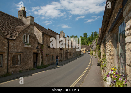 Main street through the pretty picturesque Cotswold village of Castle Combe near Chippenham in Wiltshire on a sunny - Stock Photo