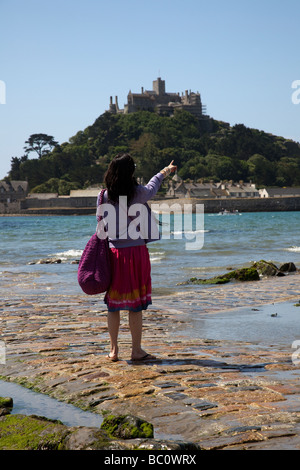 Chinese Tourist on the Causeway at St Michaels Mount, Marazion, near Penzance in Cornwall, UK - Stock Photo