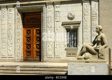 Statue of a woman at the entrance to the Centre William Rappard, headquarters of the World Trade Organization Geneva - Stock Photo