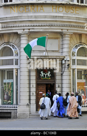 The Nigerian Embassy in London with National flag flying and entrance doors being opened to visitors - Stock Photo