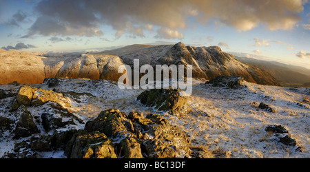 The Langdale Pikes at dawn in winter, taken from The Band, Bowfell, English Lake District - Stock Photo