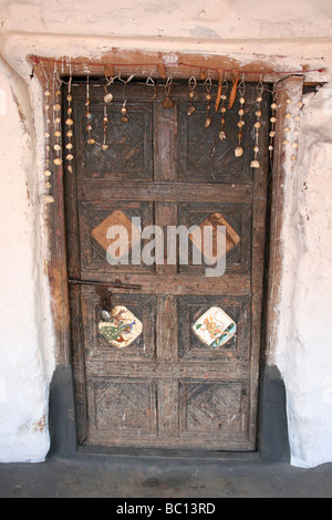 Traditionally Decorated House Door In A Typical Paroja Tribe Village In Orissa, India - Stock Photo