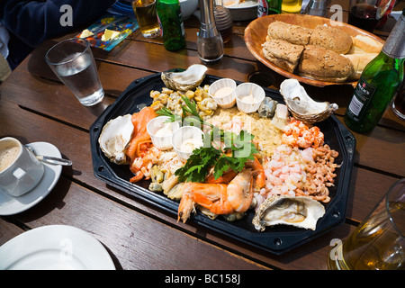 A seafood platter for four, served at an outdoor seafood restaurant, in the seaside town of Swanage, Dorset. UK. - Stock Photo