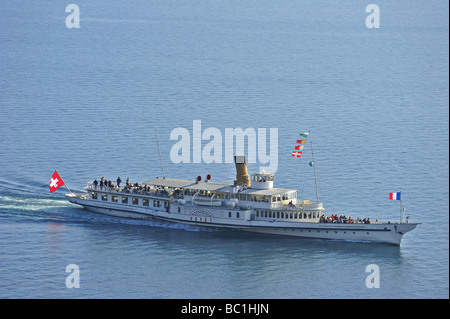 The Swiss paddle steamer 'Vevey' on Lac Leman. Space for text on water above boat. - Stock Photo