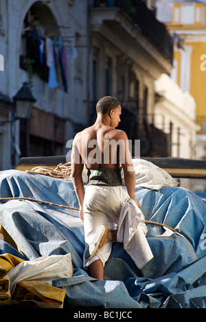 Cuban haulage worker on the back of a truck in Old Havana. Cuba - Stock Photo