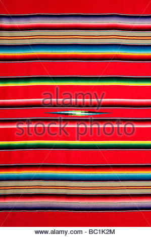 A traditional brightly colored Mexican Blanket this is an older version with higher quality weaving and brighter - Stock Photo