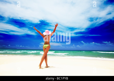 Woman have a fun time on the tropical beach - Stock Photo