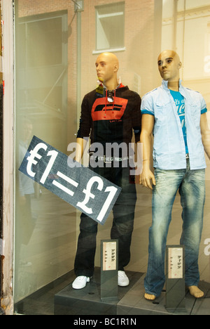 Belfast clothes shop One euro equals one pound - Stock Photo
