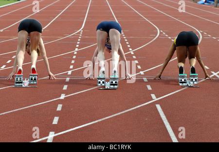 Runners in starting blocks - Stock Photo