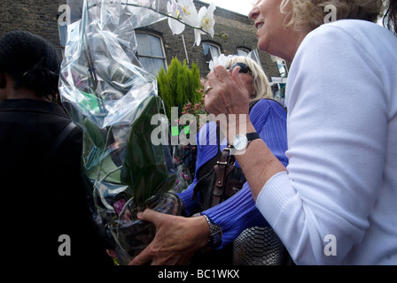 June 21st Columbia Road flower market on a Sunday morning - Stock Photo
