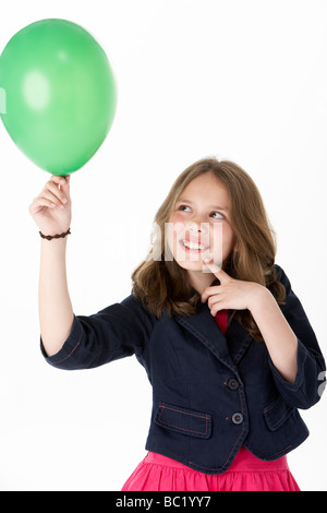 Young Girl Holding Party Balloon - Stock Photo