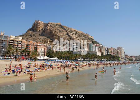 summer crowds on Postiguet Beach, Alicante city, Alicante Province, Comunidad Valenciana, Spain - Stock Photo