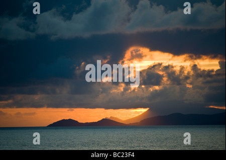 A fire like sunset over Clew Bay in County Mayo Ireland with ocean and mountain views - Stock Photo