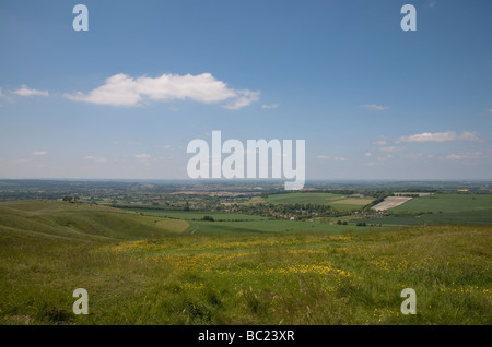 view over the north Wiltshire countryside from the top of Cherhill Down near Calne on a sunny summer day - Stock Photo
