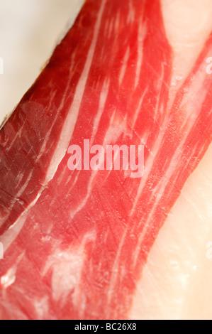 Cutting Spanish ham, process of preparation and it cuts - Stock Photo
