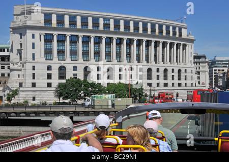 London open top tour bus tourist passengers and view of Unilever House Blackfriars London England UK - Stock Photo