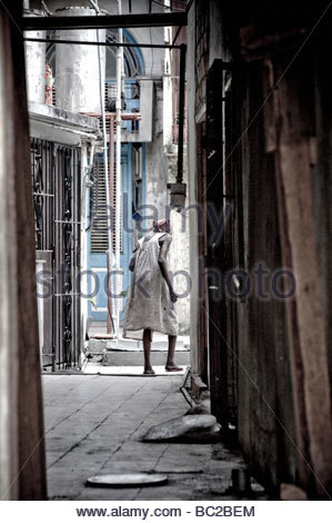old lady in alleyway - Stock Photo