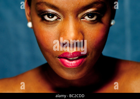 close up of a black woman wearing red lipstick - Stock Photo