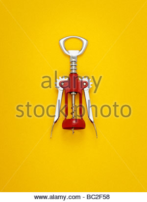 corkscrew photographed on a yellow background - Stock Photo