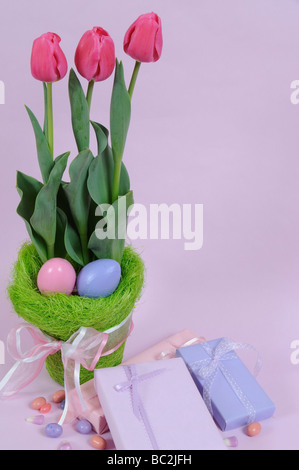 Tulips and Easter Eggs with Gifts and Candy - Stock Photo
