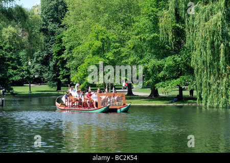 Swan boat in Boston Public Gardens located adjacent to the Boston Common, Boston, MA USA - Stock Photo