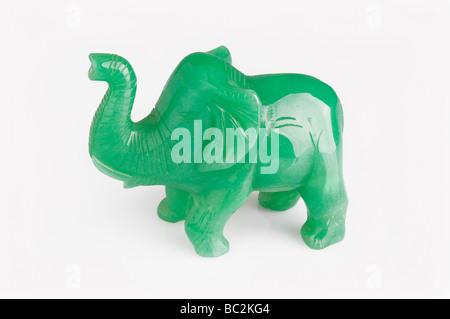 Jadeite elephant carving on white background - Stock Photo