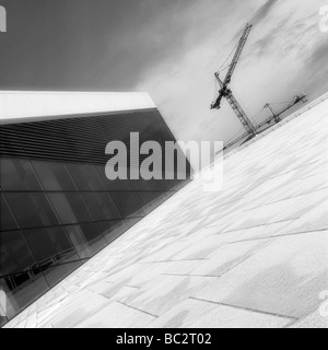 The construction crains along with new Oslo opera house - Stock Photo