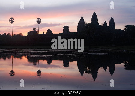 [Angkor Wat] temple, silhouette of ruins and beautiful sky reflected in water at sunrise, Cambodia, [Southeast Asia] - Stock Photo