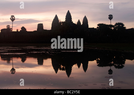 [Angkor Wat] temple complex, silhouette of ruins reflected in water at sunrise, Cambodia, [Southeast Asia] - Stock Photo