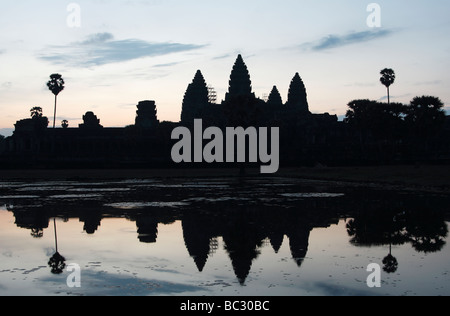 [Angkor Wat] temple, silhouette of ruins reflected in water at dawn, Cambodia, [Southeast Asia] - Stock Photo