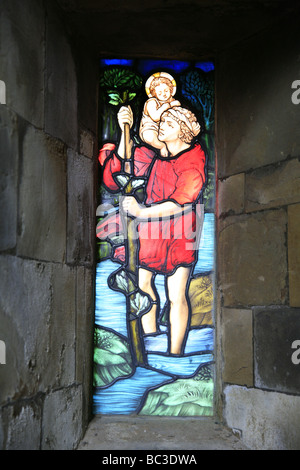 A Depiction of Saint Christopher Carrying Christ Across the River Bloxham Church Oxfordshire - Stock Photo