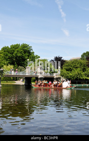 Swan boat and footbridge in Boston Public Gardens located adjacent to Boston Common, Boston MA USA