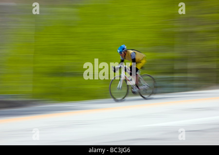Cyclists riding on Highway 50 over Monarch Pass in Colorado during the annual Ride The Rockies bicycle tour - Stock Photo