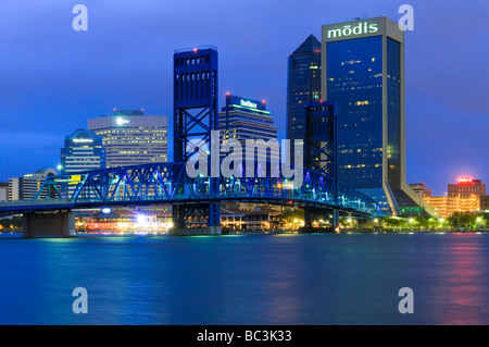 Jacksonville Florida downtown skyline reflects in St Johns River - Stock Photo