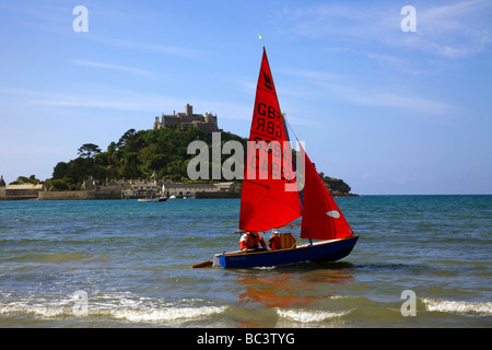 Sailing boats with red sail, a Mirror Dingy at Marazion, near St Michael's Mount, Penzance in Cornwall, England - Stock Photo