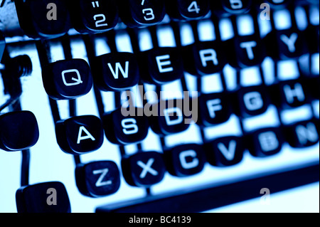 Old fashioned qwerty typewriter keys - Stock Photo