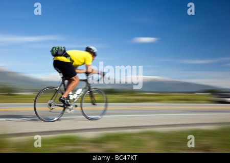 Cyclists riding between Salida and Buena Vista in Colorado during the annual Ride The Rockies bicycle tour - Stock Photo