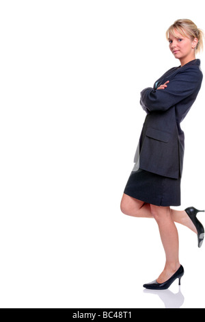 Blond businesswoman in suit standing leaning against something isolated on a white background - Stock Photo
